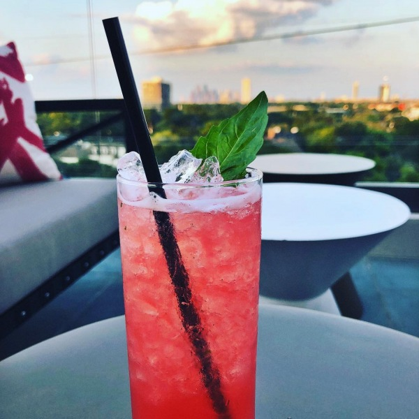 Cool off with a refreshing beverage from The Loft.... Only at The Ivy River Oaks! #lovewhereyoulive #anivyresidentexclusive #summertexasheat #downtownviews #riveroaks
